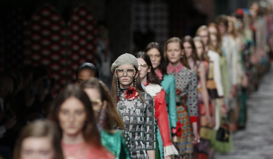 Models wear creations for Gucci women's Spring-Summer 2016 collection, part of the Milan Fashion Week, unveiled in Milan, Italy, Wednesday, Sept. 23, 2015. (AP Photo/Luca Bruno)