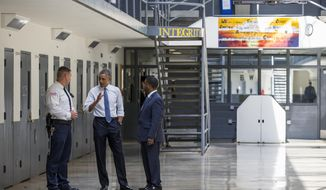 """President Barack Obama speaks during a tour with the Bureau of Prisons Director Charles Samuels (right) and correctional officer Ronald Warlick at the El Reno Federal Correctional Institution in El Reno, Okla., on July 16, 2015. An HBO documentary, """"Fixing the System,"""" that features President Obama's historic visit to the prison and his in-depth conversations with six of the inmates, premiered Wednesday, Sept. 23, 2015, at the prison before a group of inmates. (Associated Press) **FILE**"""