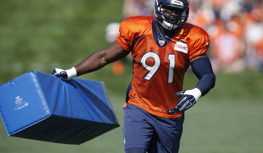 In this Sunday, Aug. 2, 2015 photo, Denver Broncos defensive end Kenny Anunike runs with a tackling dummy at the team's NFL football training camp in Englewood, Colo. Anunike returned to practice in late September after recovering from right knee surgery in mid-August and said he's hopeful to play at Detroit on Sunday, Sept. 27, 2015. (AP Photo/David Zalubowski)