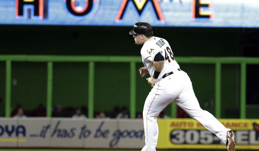 Miami Marlins' Justin Bour (48) runs the bases after hitting a solo home run in the fourth inning of a baseball game against the Philadelphia Phillies, Wednesday, Sept. 23, 2015, in Miami. (AP Photo/Lynne Sladky)