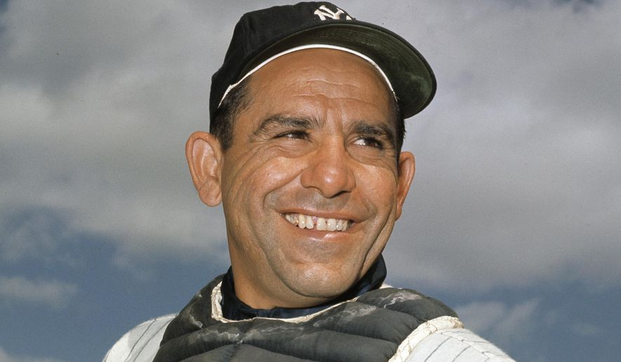 """In this undated file photo, New York Yankee catcher Yogi Berra poses at spring training in Florida. The Hall of Fame catcher renowned as much for his lovable, linguistically dizzying """"Yogi-isms"""" as his unmatched 10 World Series championships with the New York Yankees, died Tuesday, Sept. 22, 2015. He was 90. (AP Photo/File)"""