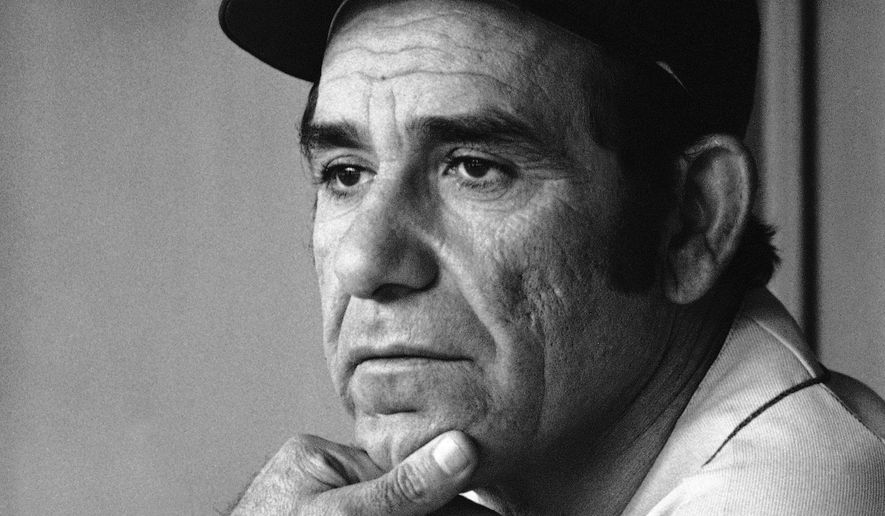 File-This Sept. 21, 1973, file photo shows Yogi Berra, manager of the New York Mets, watching his team work during a game in Philadelphia. Berra, the Yankees Hall of Fame catcher has died. He was 90. (AP Photo/Ray Stubblebine, File)