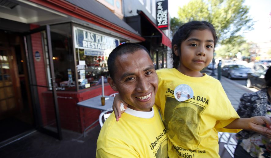 Raul Cruz, from suburban Los Angeles, holds his daughter Sophie Cruz, 5, after an interview with the Associated Press in Washington, Wednesday, Sept. 23, 2015. Sophie crossed a police barricade to greet Pope Francis during his parade. (AP Photo/Alex Brandon)