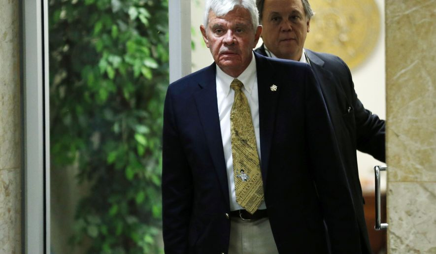 Tulsa County sheriff Stanley Glanz, left, and attorney Scott Wood walk on the sixth floor of the Tulsa County Courthouse following a closed-door meeting on day 17 of the grand jury investigation of the Tulsa County Sheriff's Office, on Wednesday, Sept. 23, 2015. (Cory Young/Tulsa World via AP)