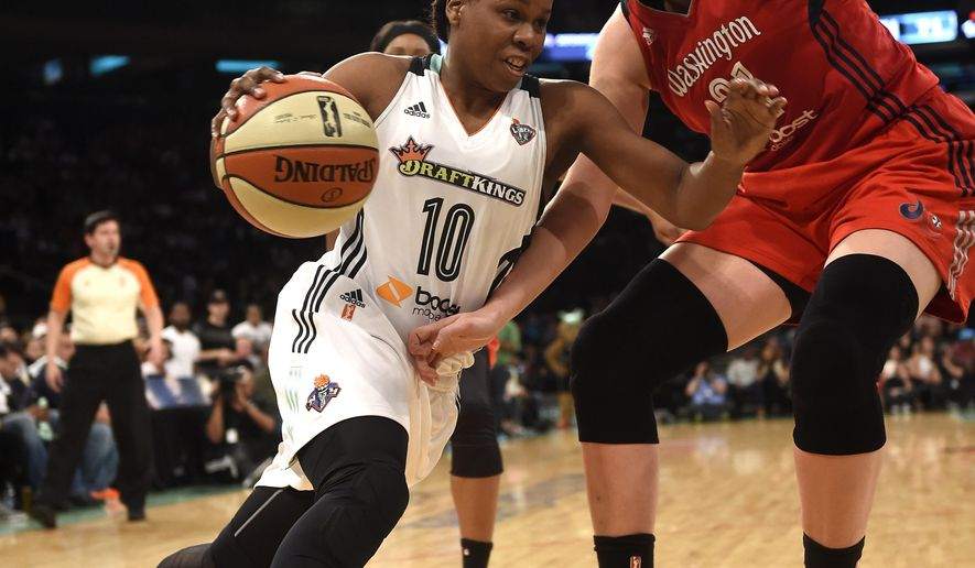New York Liberty guard Epiphanny Prince (10) drives the ball around Washington Mystics center Stefanie Dolson (31) during the second half of Game 6 of the WNBA basketball Eastern Conference semifinals, Tuesday, Sept. 22, 2015 in New York. The Liberty won 79-74. (AP Photo/Kathy Kmonicek)