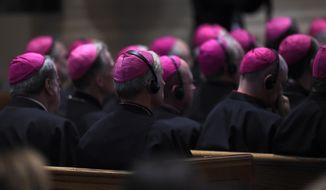 Bishops listen to Pope Francis during the midday prayer from the Liturgy of Hours, the daily form of prayer of the Catholic Church, with bishops from the U.S., Wednesday, Sept. 23, 2015 at the Cathedral of St. Matthew the Apostle in Washington. (AP Photo/Susan Walsh)