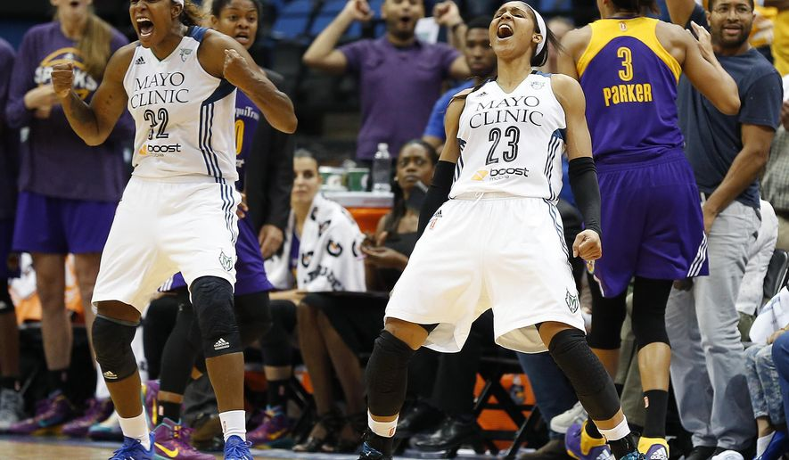 Minnesota Lynx's Rebekkah Brunson (32) and Maya Moore (23) react to a foul call against the Los Angeles Sparks during the second half of Game 3 of a WNBA basketball Western Conference semifinal series, Tuesday, Sept. 22, 2015, in Minneapolis. The Lynx won 91-80. (AP Photo/Stacy Bengs)