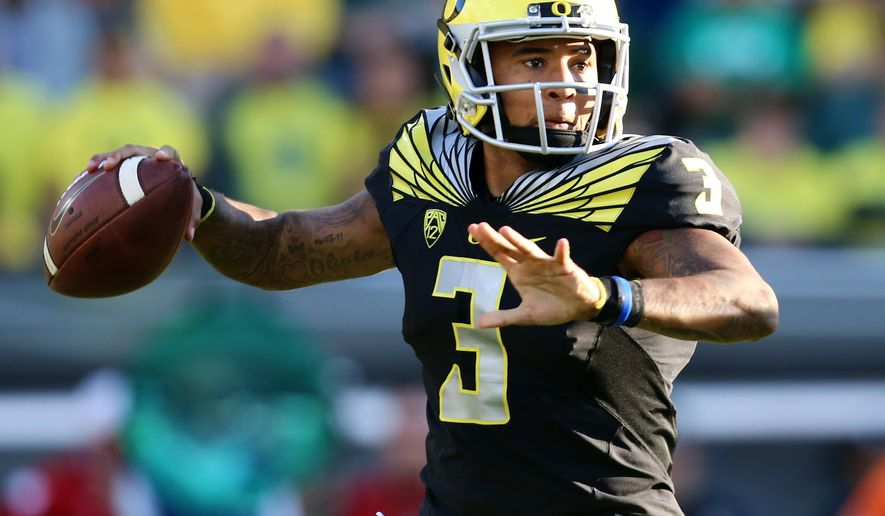 FILE- In this Sept. 5, 2015, file photo, Oregon quarterback Vernon Adams Jr. (3) looks to throw during the first half of an NCAA college football game against Eastern Washington in Eugene, Ore.  In a a Pac-12 crossover game, No. 18 Utah visits No. 13 Oregon, which hopes to have quarterback Vernon Adams back after he sat out last week with a broken finger. (AP Photo/Ryan Kang, File)