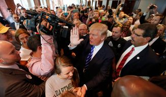 Republican presidential candidate, businessman Donald Trump, waves to supporters as he makes his way out of the building after speaking at an event sponsored by the Greater Charleston Business Alliance and the South Carolina African American Chamber of Commerce at the Charleston Area Convention Center in North Charleston, S.C., Wednesday, Sept. 23, 2015. (AP Photo/Mic Smith) ** FILE **