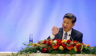 Chinese President Xi Jinping speaks at a U.S.-China business roundtable, comprised of U.S. and Chinese CEOs, Wednesday, Sept. 23, 2015, in Seattle. The Paulson Institute, in partnership with the China Council for the Promotion of International Trade, co-hosted the event. (AP Photo/Elaine Thompson, Pool)