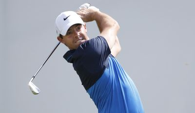 Rory McIlroy, of Northern Ireland, watches his tee shot on the first hole during the final round of the BMW Championship golf tournament at Conway Farms Golf Club, Sunday, Sept. 20, 2015, in Lake Forest, Ill. (AP Photo/Charles Rex Arbogast)