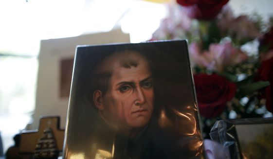 A portrait of Franciscan missionary Junipero Serra can be seen in the gift shop of the Mission San Diego de Acala in San Diego. (Associated Press)