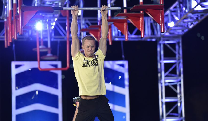 """American Ninja Warrior"" contestant Geoff Britten completes ""The Floating Bars"" during Stage 3 in Las Vegas. Britten, a cameraman, laid claim to being the first person in seven years to complete the entire course, but did not win the $1 million prize. (Courtesy David Becker/NBC)"