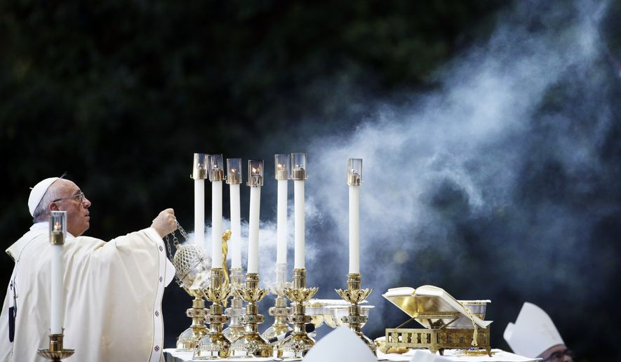 Pope Francis conducts Mass outside the Basilica of the National Shrine of the Immaculate Conception on Wednesday, Sept. 23, 2015, in Washington. (Associated Press)