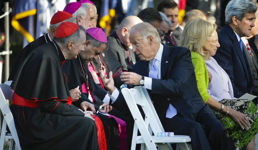 Vice President Joe Biden, right, leans back to talk with Vatican Secretary of State Cardinal Pietro Parolin, left, and other members of the Catholic leadership as they all wait for Pope Francis to arrive before the start of the State Arrival on the South Lawn of the White House, Washington, Wednesday, Sept. 23, 2015. (AP Photo/Pablo Martinez Monsivais)
