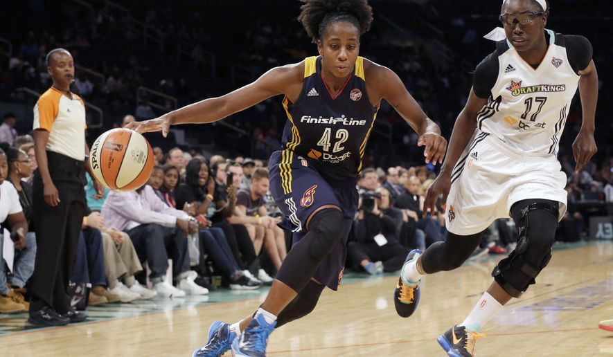 Indiana Fever guard Shenise Johnson (42) drives to the basket past New York Liberty forward Essence Carson (17) during the first half of Game 1 of the WNBA basketball Eastern Conference finals, Wednesday, Sept. 23, 2015 at Madison Square Garden in New York.  (AP Photo/Mary Altaffer)