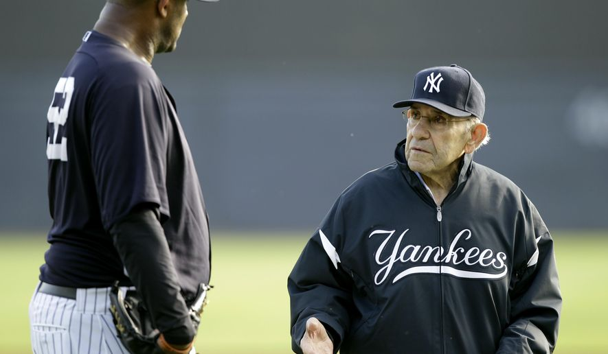 This Feb. 24, 2011, file photo shows New York Yankees pitcher CC Sabathia, left, talking with Yogi Berra, right, during a baseball spring training workout at Steinbrenner Field in Tampa, Fla. Berra, the Yankees Hall of Fame catcher has died. He was 90.( AP Photo/Charlie Neibergall, File)