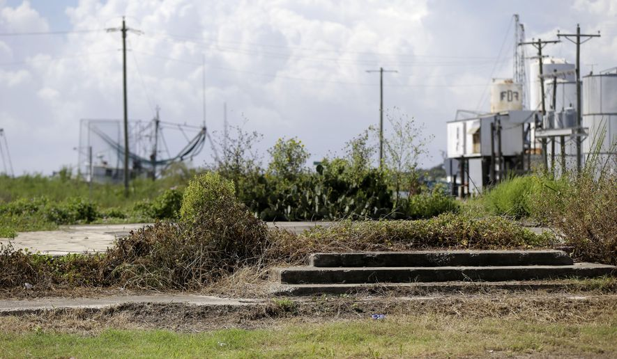 Steps and a slab, lingering damage from Hurricane Rita which hit in 2005, are seen in Cameron, La., Tuesday, Sept. 15, 2015. A decade after Hurricane Rita, Cameron Parish in coastal, southwest Louisiana still bears the scars of her wrath. Thursday, Sept. 24, 2015 is the anniversary of Hurricane Rita.  (AP Photo/Gerald Herbert)
