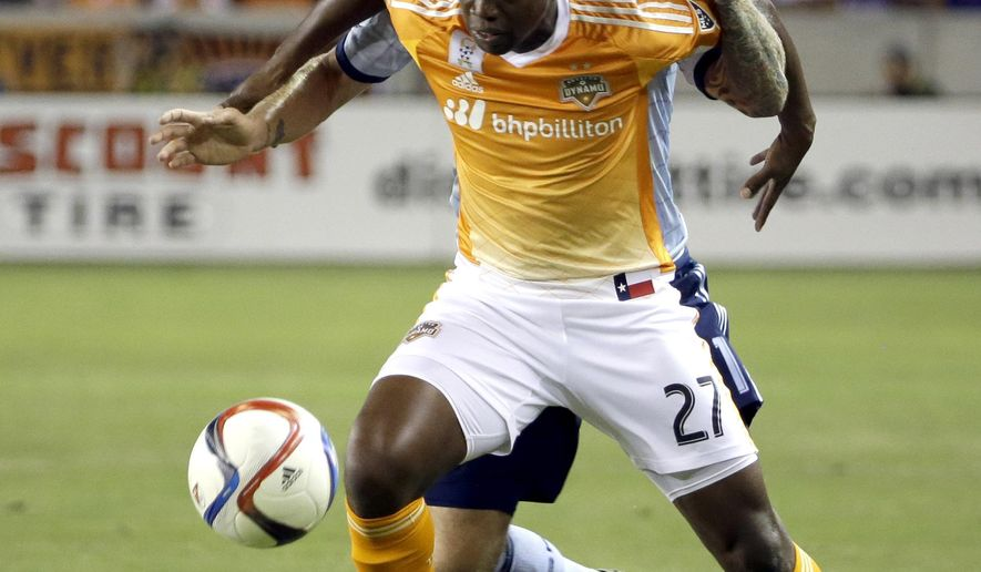 Houston Dynamo's Boniek Garcia (27) keeps Sporting Kansas City's Marcel de Jong from the ball during the first half of a MLS soccer match Wednesday, Sept. 23, 2015, in Houston. (AP Photo/David J. Phillip)