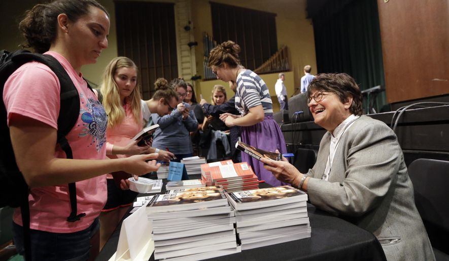 "Sister Helen Prejean, right, signs copies of her books, including ""Dead Man Walking,"" after speaking at Belmont University Wednesday, Sept. 23, 2015, in Nashville, Tenn.  Prejean is the spiritual adviser for Richard Glossip, the Oklahoma inmate who just got a last minute reprieve from execution. (AP Photo/Mark Humphrey)"