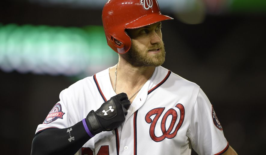 Washington Nationals' Bryce Harper walks back to the dugout after he popped out during the third inning of a baseball game against the Baltimore Orioles, Tuesday, Sept. 22, 2015, in Washington. The Orioles won 4-1. (AP Photo/Nick Wass)