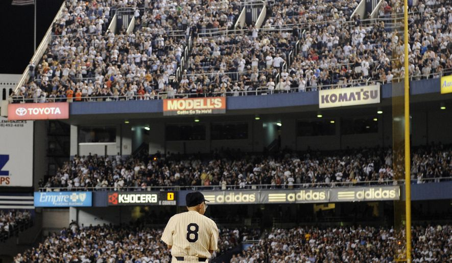 "FILE - In this Sept. 21, 2008, file photo, former New York Yankees catcher Yogi Berra stands at home plate at Yankee Stadium in New York, before the Yankees played the Baltimore Orioles in the final regular season baseball game at the stadium. The Hall of Fame catcher renowned as much for his lovable, linguistically dizzying ""Yogi-isms"" as his unmatched 10 World Series championships with the New York Yankees, died Tuesday, Sept. 22, 2015. He was 90.  (AP Photo/Ed Betz, File)"