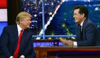 """In this photo provided by CBS, Republican presidential candidate Donald Trump, left, joins host Stephen Colbert on the set of """"The Late Show with Stephen Colbert,"""" Tuesday, Sept. 22, 2015, in New York. (John Paul Filo/CBS via AP)"""
