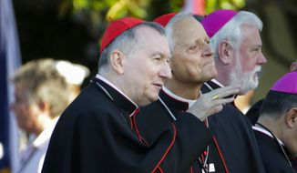 Vatican Secretary of State Cardinal Pietro Parolin, left, and Cardinal Donald Wuerl, archbishop of Washington, right, talk before taking their seats on the South Lawn of the White House in Washington, Wednesday, Sept. 23, 2015, for a state visit hosted by President Barack Obama for Pope Francis. (AP Photo/Pablo Martinez Monsivais)