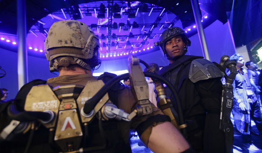 "FILE - In this June 10, 2014 file photo, models dressed as characters from the video game ""Call of Duty"" stand at the Activision booth at the Electronic Entertainment Expo, in Los Angeles. Activision is expanding its ""Call of Duty"" e-sports competition from an annual tournament to a year-round season. (AP Photo/Jae C. Hong, File)"