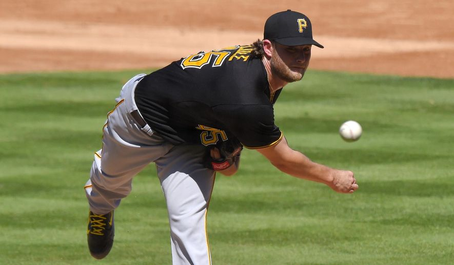 Pittsburgh Pirates starting pitcher Gerrit Cole throws to the plate during the second inning of a baseball game against the Los Angeles Dodgers, Sunday, Sept. 20, 2015, in Los Angeles. (AP Photo/Mark J. Terrill)