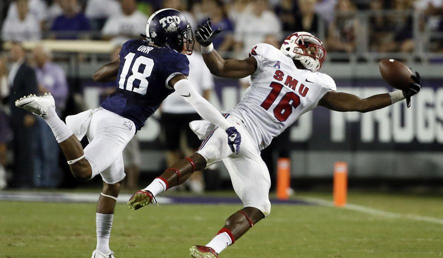 SMU wide receiver Darius Joseph (18) grabs a pass against TCU safety Nick Orr (18), which was called back because of a holding penalty, during the first half of an NCAA college football game Saturday, Sept. 19, 2015, in Fort Worth, Texas. (AP Photo/Tony Gutierrez)