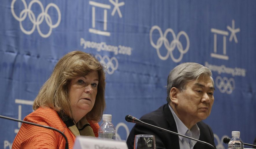 Gunilla Lindberg, left, chair of the IOC coordination commission for the 2018 Winter Games in Pyeongchang, speaks as Cho Yang-ho, president of the Pyeongchang 2018 Winter Olympics Organizing Committee, listens during a press conference in Pyeongchang, South Korea, Thursday, Sept. 24, 2015. The International Olympic Committee is pushing South Korean organizers to complete venues in time for crucial test events ahead of the 2018 Winter Games in Pyeongchang.(AP Photo/Ahn Young-joon)