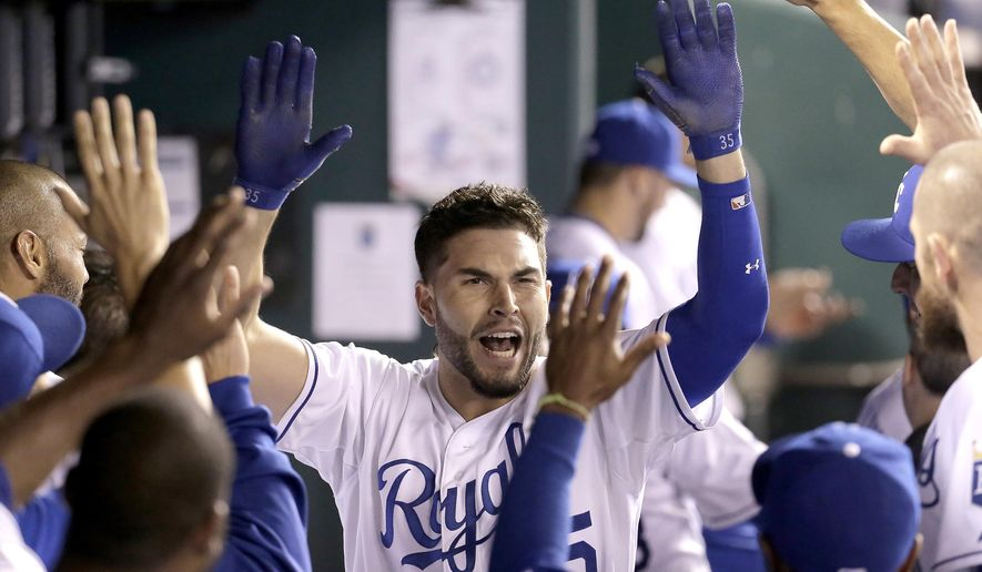 Kansas City Royals' Eric Hosmer celebrates in the dugout after hitting a solo home run to tie the score during the fifth inning of a baseball game against the Seattle Mariners on Thursday, Sept. 24, 2015, in Kansas City, Mo. (AP Photo/Charlie Riedel)
