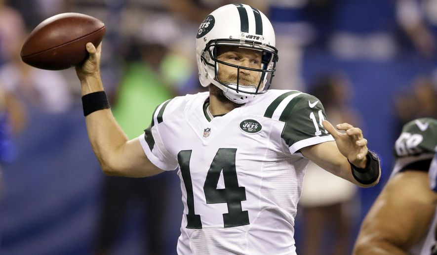 New York Jets quarterback Ryan Fitzpatrick (14) throws against the Indianapolis Colts in the first half of an NFL football game in Indianapolis, Monday, Sept. 21, 2015. (AP Photo/Darron Cummings)