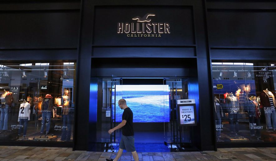 A shopper walks past the entrance to the clothing retailer Hollister, at Flatirons Crossing Mall, in Broomfield, Colo., on Thursday Sept. 24, 2015. Hollister Co. has agreed to remodel entrances to dozens of its beach-house style stores across the country to make them wheelchair accessible as part of a proposed settlement agreement with the Colorado Cross-Disability Coalition. (AP Photo/Brennan Linsley)