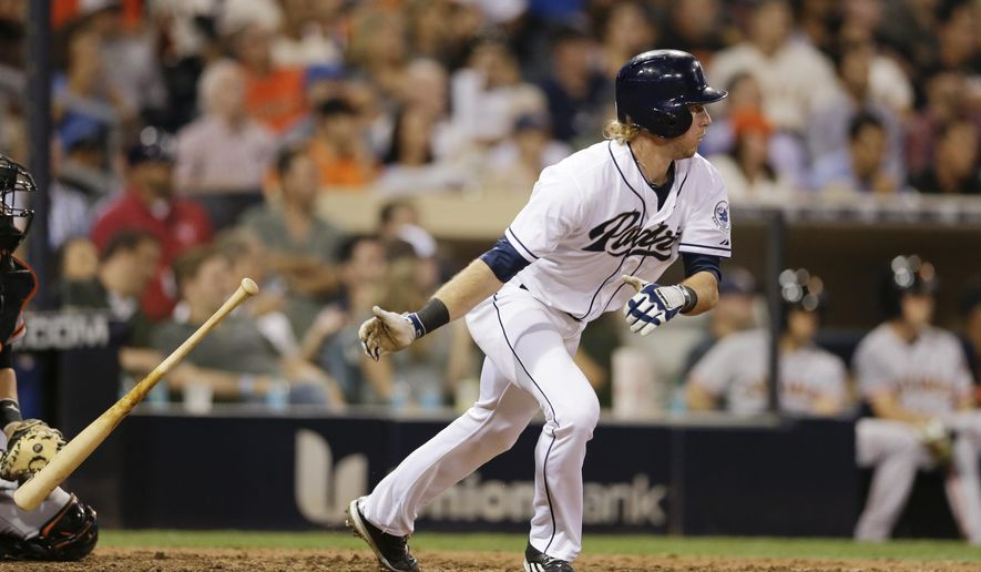San Diego Padres' Travis Jankowski watches his two-run double against the San Francisco Giants during the eighth inning of a baseball game Wednesday, Sept. 23, 2015, in San Diego. (AP Photo/Gregory Bull)