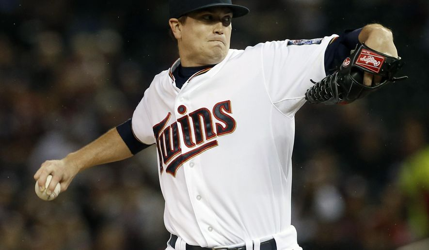Minnesota Twins pitcher Kyle Gibson throws against the Cleveland Indians in the first inning of a baseball game, Thursday, Sept. 24, 2015, in Minneapolis. (AP Photo/Jim Mone)
