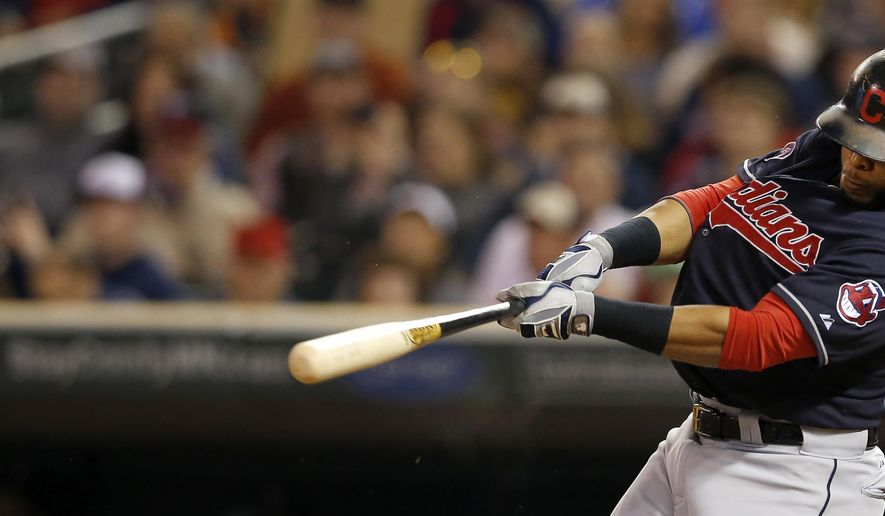 Cleveland Indians Carlos Santana hits a three-run home run off of Minnesota Twins starter Kyle Gibson during the third inning of a baseball game, Thursday, Sept. 24, 2015 in Minneapolis. (Carlos Gonzalez/Star Tribune via AP)  MANDATORY CREDIT; ST. PAUL PIONEER PRESS OUT; MAGS OUT; TWIN CITIES LOCAL TELEVISION OUT