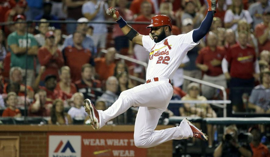 St. Louis Cardinals' Jason Heyward scores on a single by Stephen Piscotty during the seventh inning of a baseball game against the Milwaukee Brewers on Thursday, Sept. 24, 2015, in St. Louis. (AP Photo/Jeff Roberson)