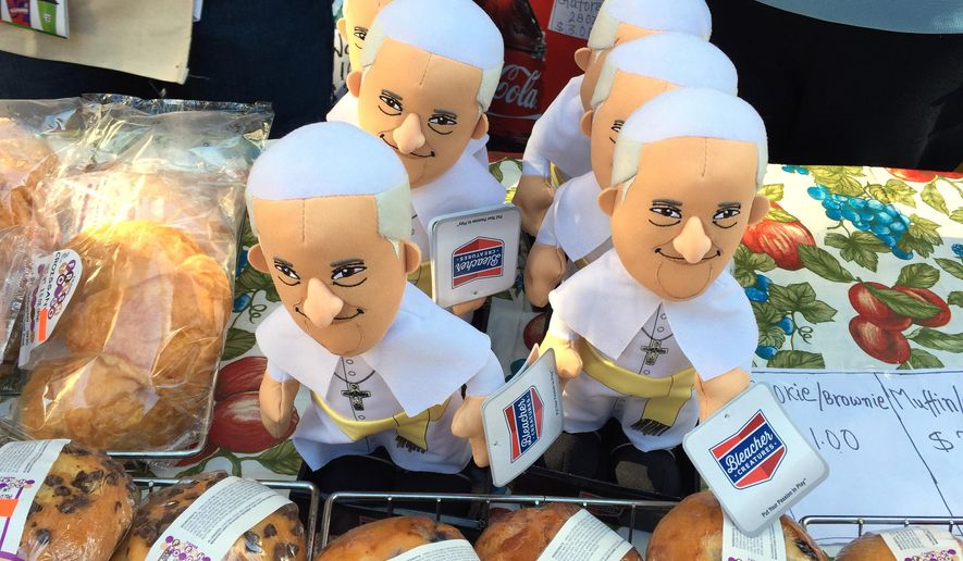 Pope Francis dolls nestled among baked goods are offered for sale at a 7-Eleven store in the Times Square area of New York Thursday, Sept. 24, 2015. Souvenirs are popping up all over the city to mark the pope's visit to New York on Sept 24 and 25. (AP Photo/Jocelyn Noveck)