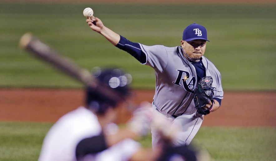 Tampa Bay Rays starting pitcher Erasmo Ramirez delivers during the first inning of a baseball game against the Boston Red Sox at Fenway Park in Boston, Thursday, Sept. 24, 2015. (AP Photo/Charles Krupa)