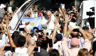 Pope Francis arrives in the popemobile at the Basilica of the National Shrine of the Immaculate Conception in Washington, Wednesday, Sept. 23, 2015, for the Canonization Mass for Junipero Serra. (Tony Gentile/Pool Photo via AP)