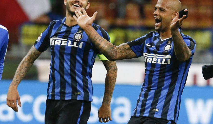 Inter Milan's Felipe Melo, right, celebrates with teammate Mauro Icardi at the end of a Serie A soccer match between Inter Milan and Hellas Verona, at the San Siro stadium in Milan, Italy, Wednesday, Sept. 23, 2015. Melo scored and Inter won 1-0. (AP Photo/Luca Bruno)