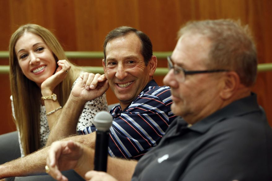 Yogi Berra's oldest granddaughter Lindsay Berra, left, and Dale Berra, son of the New York Yankees hall of fame catcher, listen as Larry Berra speaks about the passing of their father at the Yogi Berra Museum, Thursday, Sept. 24, 2015, in Little Falls, N.J. Berra died Tuesday at the age of 90. (AP Photo/Julio Cortez)