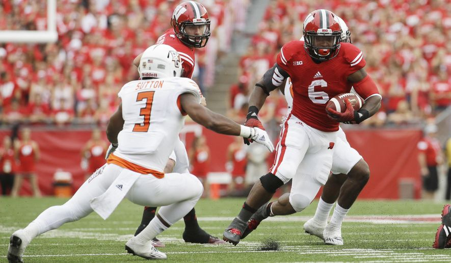 FILE - In this Saturday, Sept. 20, 2014 file photo, Wisconsin's Corey Clement runs during the second half of an NCAA college football game against Bowling Green in Madison, Wis.  Starting running back Corey Clement will miss four to six weeks for No. 22 Wisconsin to have sports hernia surgery, Thursday, Sept. 24, 2015.(AP Photo/Morry Gash, File)