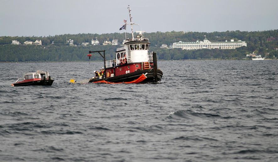 The tugboat Rochelle Kaye works with the U.S. Coast Guard during an oil spill response exercise in the Straits of Mackinac in Michigan, Thursday, Sept. 24, 2015. More than 300 people were to join the drill on Thursday, which was to simulate a leak from Line 5 in the straits. (Neil Blake/The Grand Rapids Press via AP) ALL LOCAL TELEVISION OUT; LOCAL TELEVISION INTERNET OUT; MANDATORY CREDIT