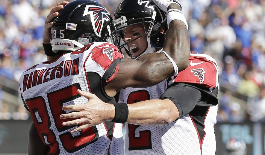 Atlanta Falcons wide receiver Leonard Hankerson, left, and quarterback Matt Ryan celebrate after Hankerson caught a touchdown pass from Ryan during the second half of an NFL football game against the New York Giants, Sunday, Sept. 20, 2015, in East Rutherford, N.J. (AP Photo/Seth Wenig)
