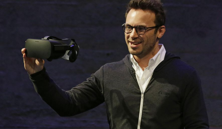 FILE - In this Thursday, June 11, 2015 file photo, Oculus CEO Brendan Iribe holds up the new Rift virtual reality headset during a news conference in San Francisco. Oculus is hosting its second annual conference for virtual reality developers, running Sept. 23-26, 2015, in Los Angeles. The company is scheduled to release the consumer edition of its Oculus Rift VR headset early next year. (AP Photo/Eric Risberg, File)