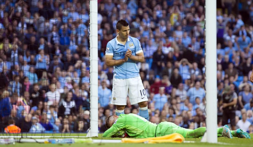 Manchester City's Sergio Aguero, top, reacts after a missed opportunity during the English Premier League soccer match between Manchester City and West Ham United at the Etihad Stadium, Manchester, England, Saturday Sept. 19, 2015. (AP Photo/Jon Super)