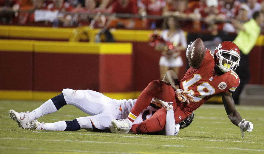 Kansas City Chiefs wide receiver Jeremy Maclin (19) is tackled by Denver Broncos cornerback Chris Harris Jr. during the second half of an NFL football game in Kansas City, Mo., Thursday, Sept. 17, 2015. (AP Photo/Charlie Riedel)
